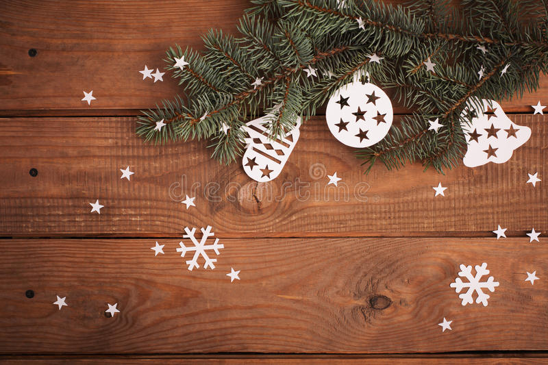 Merry Christmas cards decorations in paper cutting style hanging. On fir over wooden stock photo