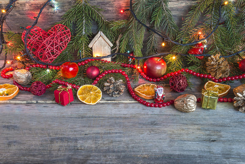 Merry Christmas: christmas decorations with illumination. On old wooden background royalty free stock image