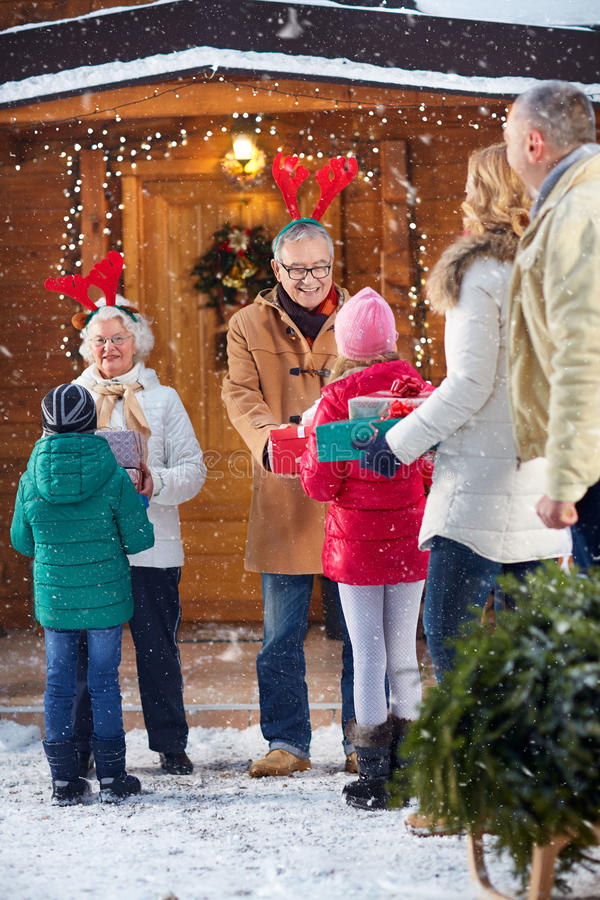 Merry Christmas concept- family with gift. Merry Christmas concept- happy family with gift stock images