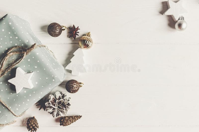 Merry christmas concept, flat lay. stylish presents and gifts wi. Th ornaments cones anise on rustic white wood top view, space for text. seasonal greetings royalty free stock images