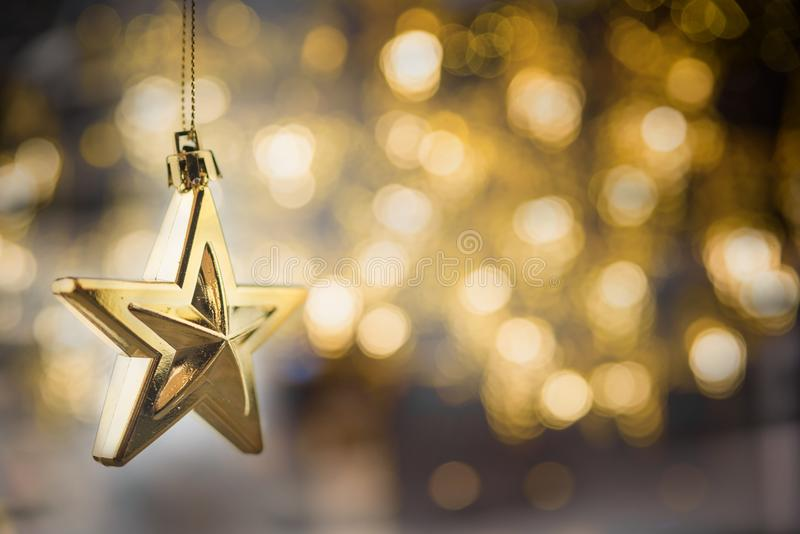 Merry Christmas concept with hanging star ornaments. On blur background royalty free stock photography