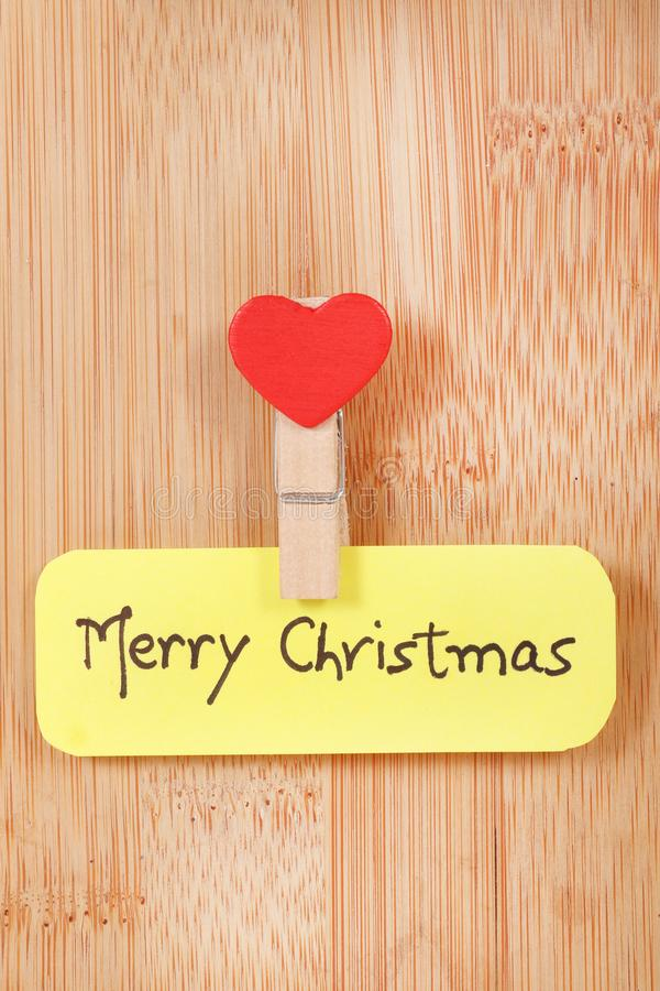 Merry christmas. Concept shot of merry Christmas written on paper chit royalty free stock photography
