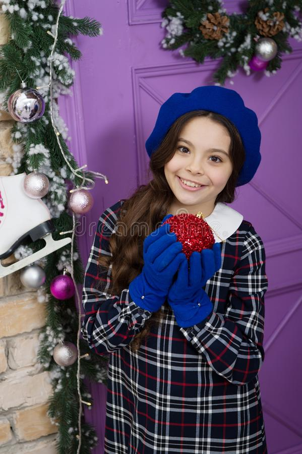 Merry christmas concept. Winter accessories. Fashion girl ready for Christmas celebration. Little fashionista wearing. Gloves. Small girl child in Christmas stock images