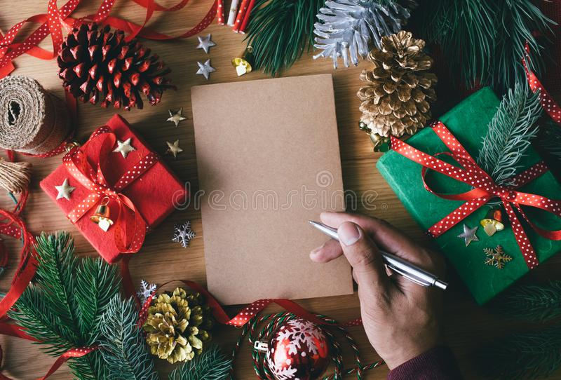 Merry christmas concepts with human hand writing greeting cards stock photography