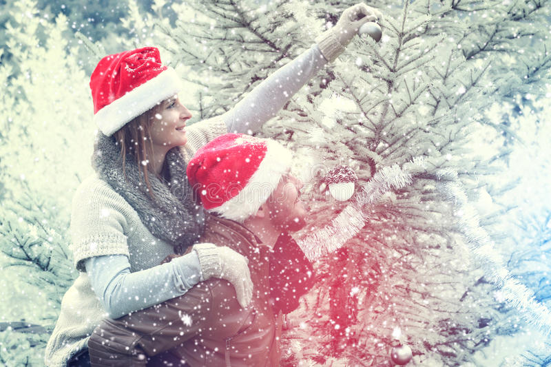 Merry Christmas.Couple celebrating Christmas outdoor. Romantic proposal scene with happy women and men for Christmas stock images