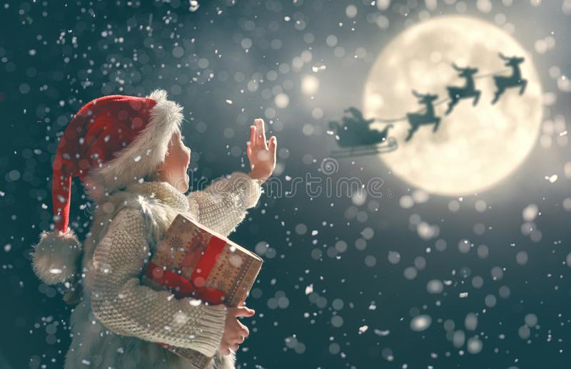 Girl with present at Christmas royalty free stock images