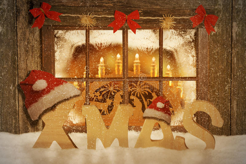 Merry Christmas. Christmas decorated windows with text Xmas royalty free stock photography