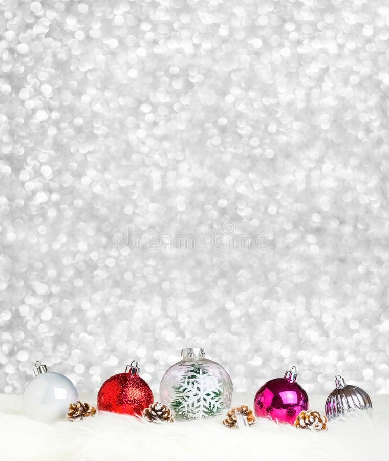 Merry Christmas decoration ball on white fur at silver bokeh light background,Banner vertical Holiday greeting card.  stock photo