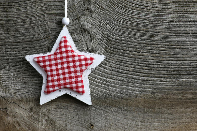 Merry Christmas Decoration White Wooden Star Gingham Fabric Pattern. Christmas handmade decoration Shabby Chic wooden star with gingham fabric pattern over stock photos