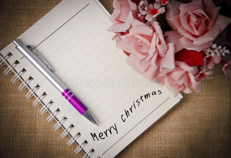 Merry Christmas on diary ring binder. On It as Christmas Background stock photo