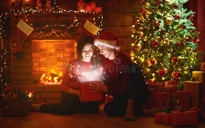 Merry Christmas! family couple with magic Christmas gift. Merry Christmas! family couple with a magic Christmas gift royalty free stock images