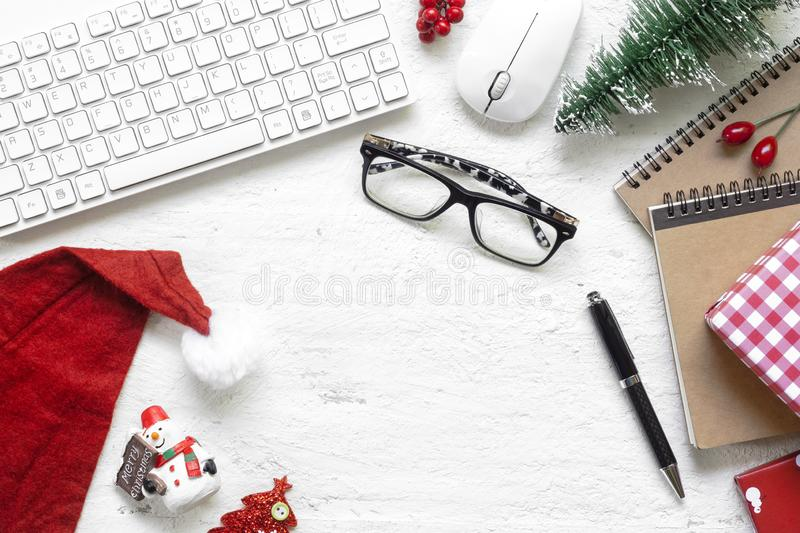 Merry Christmas Festival. Flat lay Office desk table with compu. Ter wireless mouse and keyboard and Christmas decoration toys and ornaments on rustic white stock images