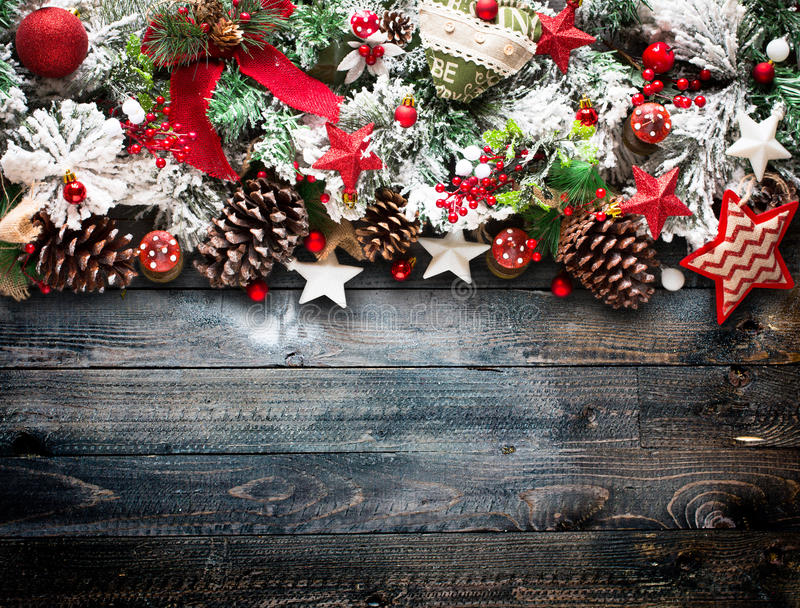 Merry Christmas Frame with green pine, colorful baubles, knots with berries and stars. Merry Christmas Frame with green pine, colorful baubles, knots with stock image