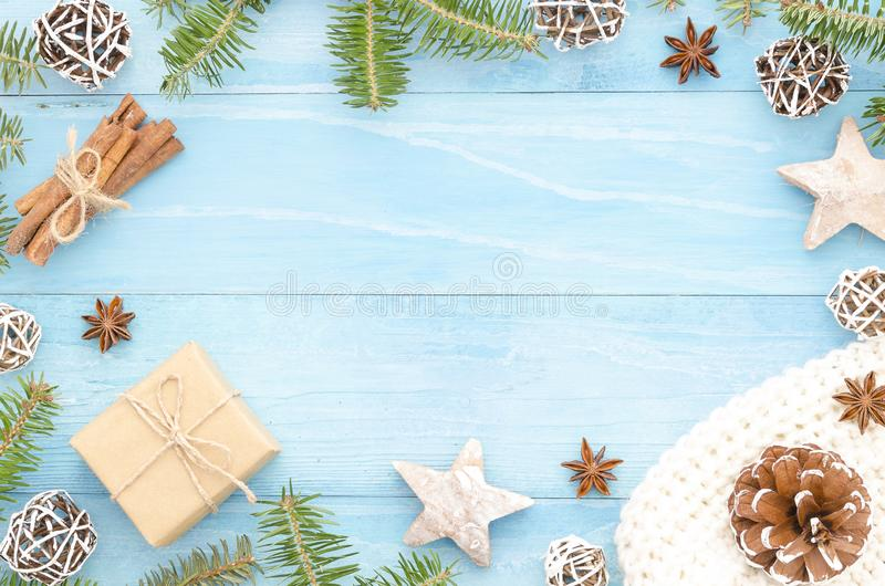 Merry Christmas frame for greeting card. Rustic blue wooden background with christmas tree, cinnamone,anice star, pine. Merry Christmas greeting card with stock images