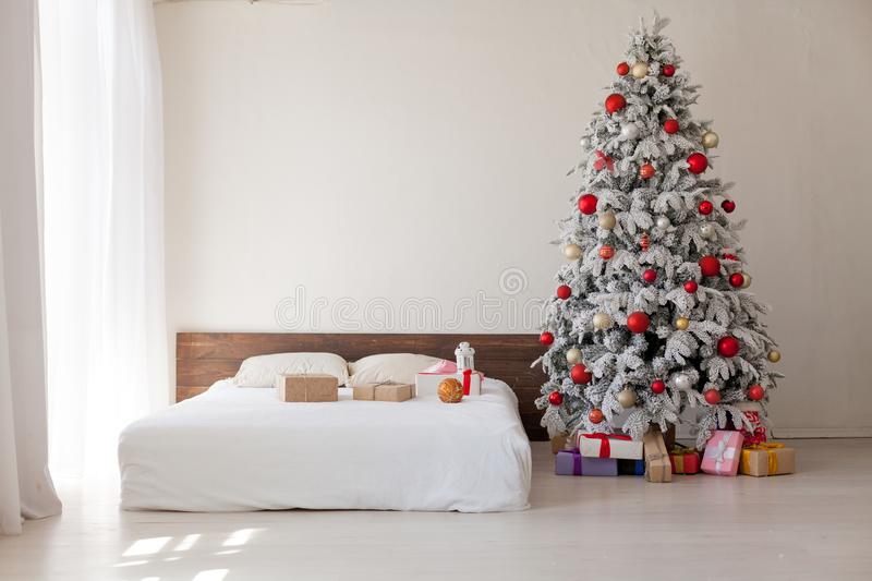 Merry Christmas gifts Interior white room holidays new year tree. Merry Christmas gifts Interior white room new year tree royalty free stock photos