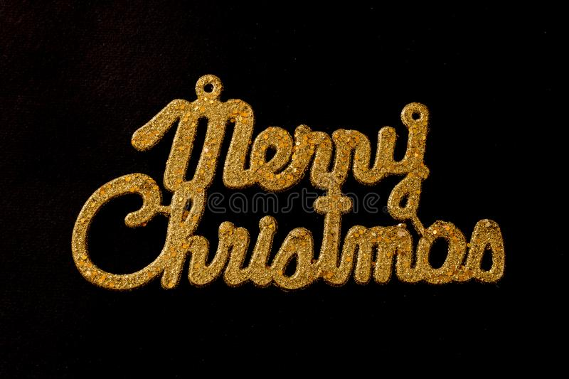 Merry Christmas golden text on a black background stock photography