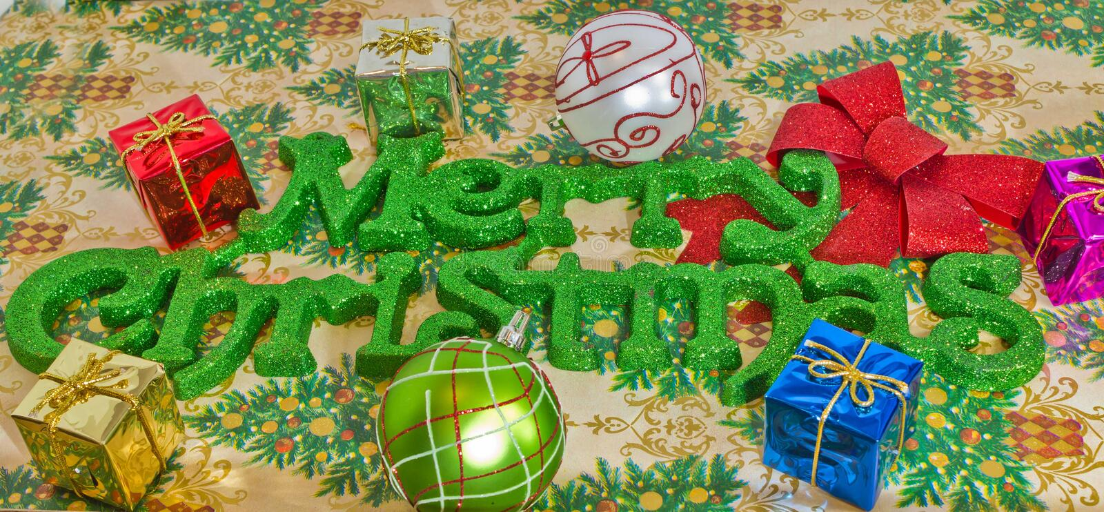 Merry Christmas in Green Lettering stock photos
