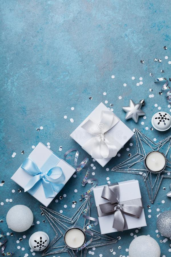 Merry christmas greeting card. Gift boxes and holiday decoration on blue table top view. Flat lay. Merry christmas greeting card. Gift boxes and holiday royalty free stock images
