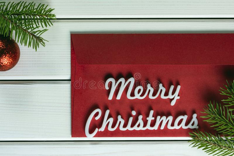 Merry christmas greeting card on white background, red envelope with Merry Christmas wordstop view with copy space. Closeup photo of Merry christmas greeting royalty free stock photography