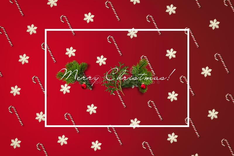 Merry Christmas greeting card with white border. Holiday card with canes. And snowflakes pattern, pine branches and balls royalty free stock photo