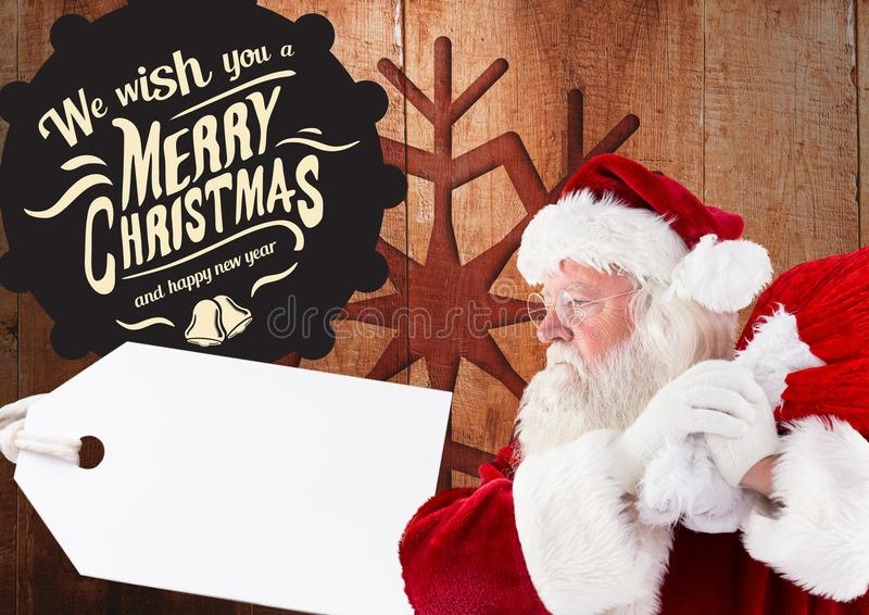 Merry christmas greetings with santa claus holding sack stock photography