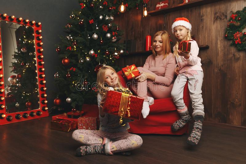 Merry Christmas and Happy Holiday Mom and daughter decorate the Christmas. Tree royalty free stock photography