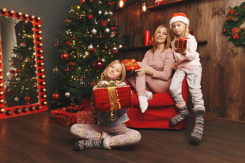 Merry Christmas and Happy Holiday Mom and daughter decorate the Christmas. Tree stock photography
