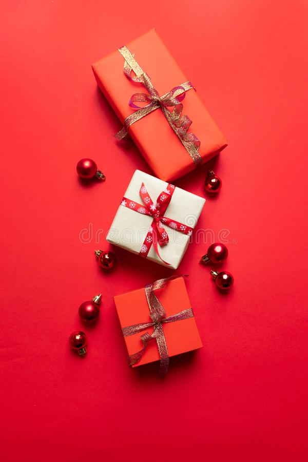 Merry Christmas and Happy Holidays banner gift boxes and red decor on background. New Year. Noel stock images