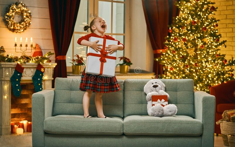 Girl with Christmas gift royalty free stock images