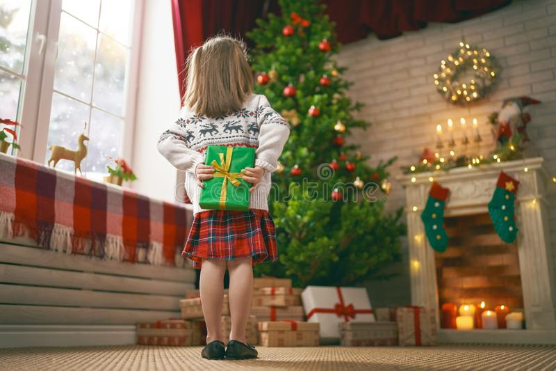 Girl with Christmas gift royalty free stock photos