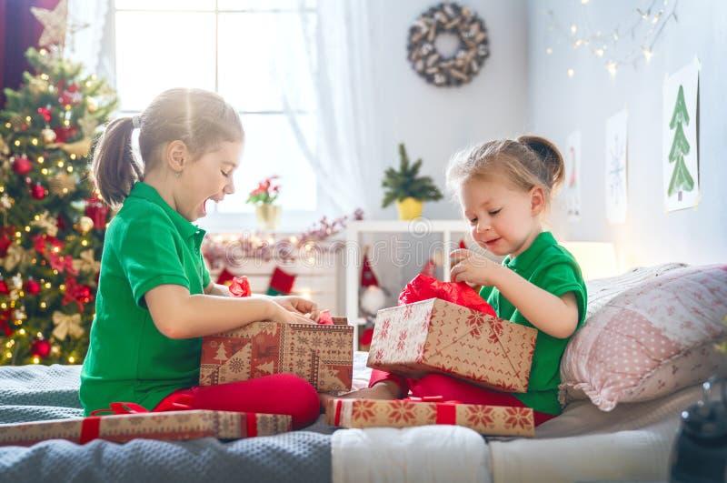 Children opening Christmas presents stock image