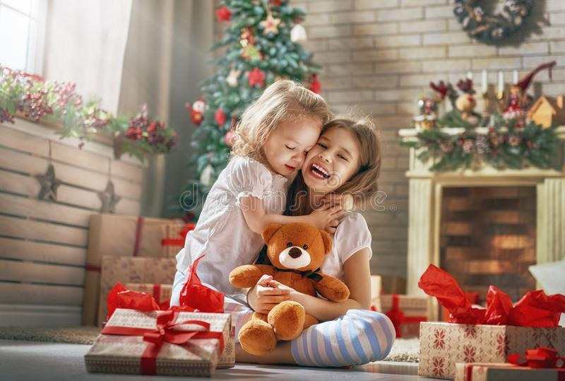 Girls opening gifts stock images