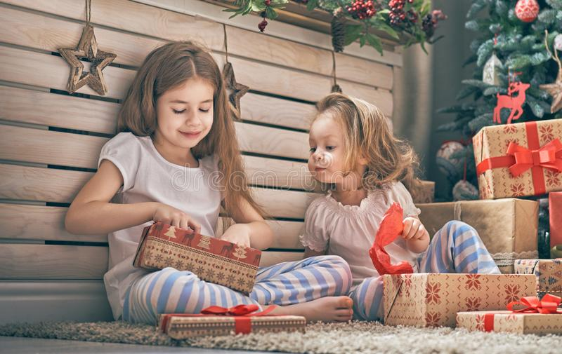 Girls opening gifts stock photo