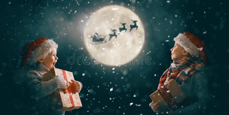 Children with xmas presents royalty free stock photos