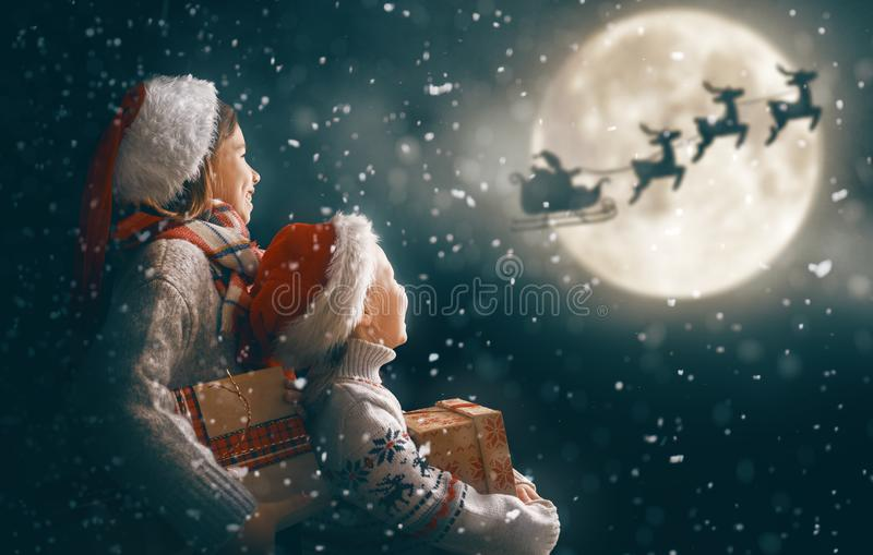 Children with xmas presents royalty free stock photo