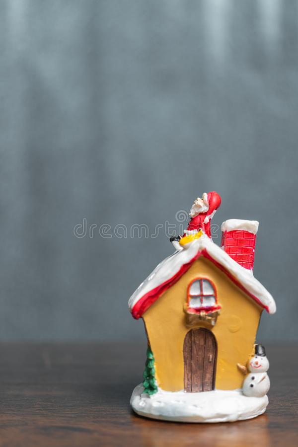 Merry Christmas and happy holidays! Cute Santa Claus sitting on. The roof, Christmas legend concept royalty free stock photo