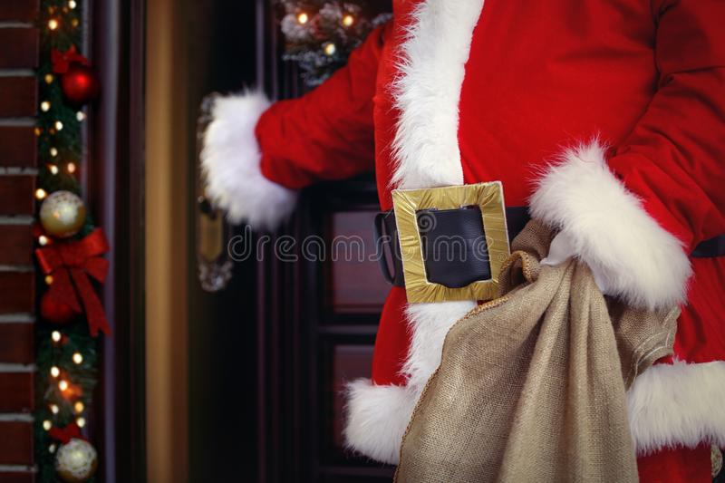 Merry Christmas and happy holidays! Santa Claus brings lots of p royalty free stock photography
