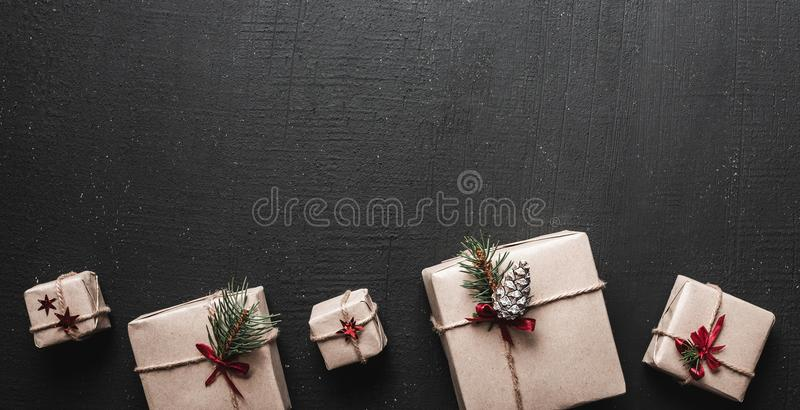 Merry Christmas and Happy Holidays! Wrapping gifts background. Handmade making christmas present, box in craft paper with ribbon. Top view. Christmas family stock photo