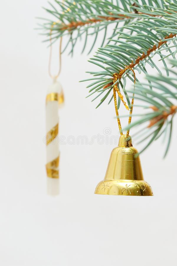 Merry christmas and a happy new year! The atmosphere of the winter holidays. Green spruce branch with decorations on a light background and free space for an stock photo