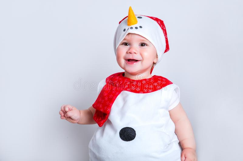 Merry christmas and happy new year. happy baby in snowman costume stock photo