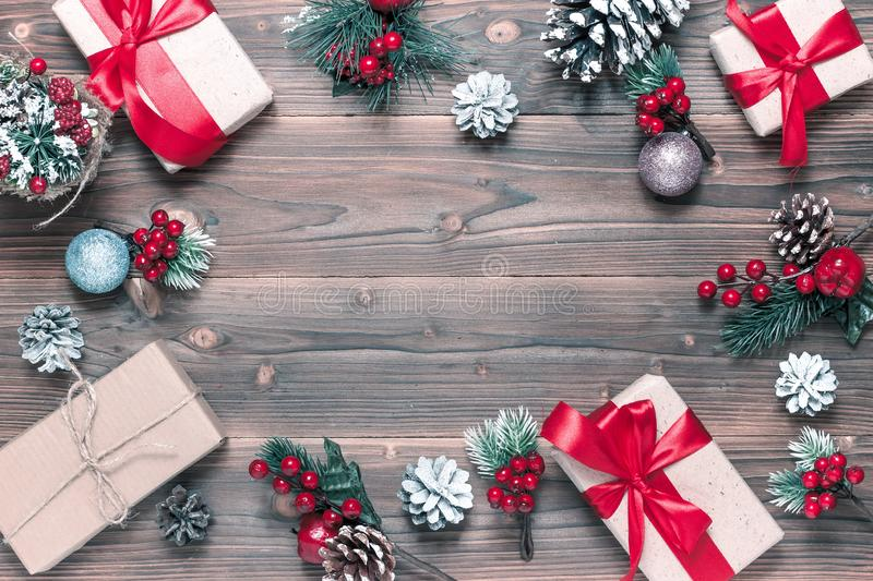 Merry christmas and happy new year background. Top view. Tree, branch, fir, santa, snow, garland, decoration, season, winter, gift, red, white, holiday, frame royalty free stock image