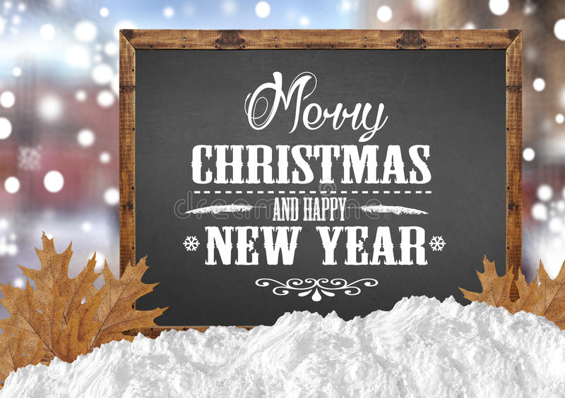 Merry Christmas and Happy New Year on blank blackboard with blur city leaves with snow royalty free stock image