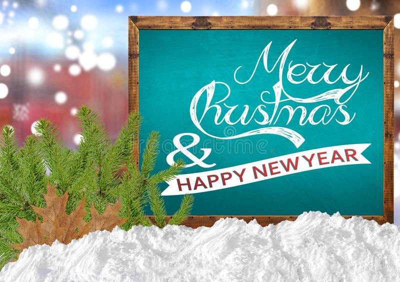 Merry Christmas and Happy New Year on blue blackboard with blurr city pine and snow. Merry Christmas and Happy New Year on blue blackboard with blurr background royalty free stock photo