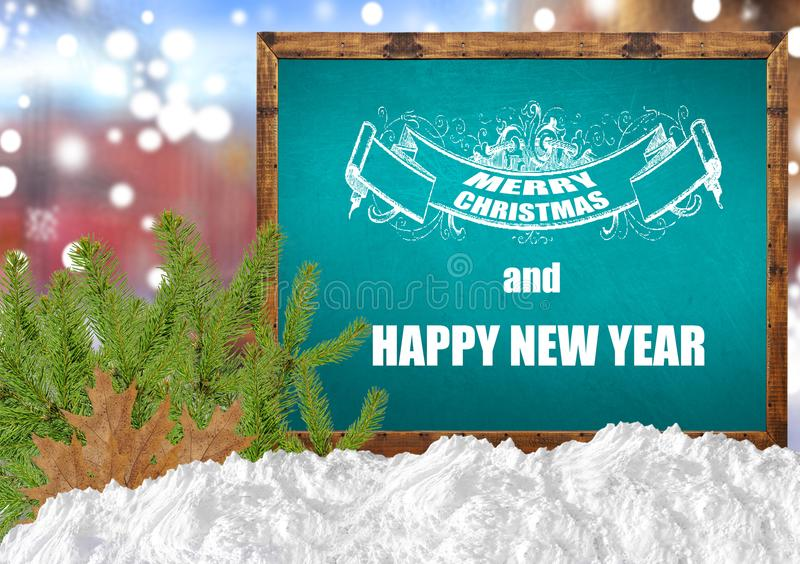 Merry Christmas and happy new year on blue blackboard with blurr city pine and snow. Merry Christmas and happy new year on blue blackboard with blurr background stock images