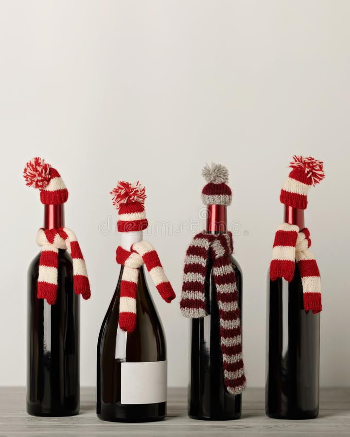 Merry Christmas and a Happy New Year! Bottles of wine in a knitted cap of Santa Claus. Selective focus stock photos