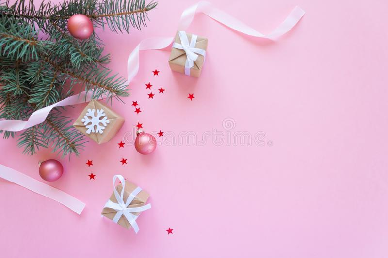 Merry Christmas and Happy New Year. Pink background. Merry Christmas and Happy New Year. Christmas Card Festive with green Fir Branches and Holiday Object on royalty free stock photos
