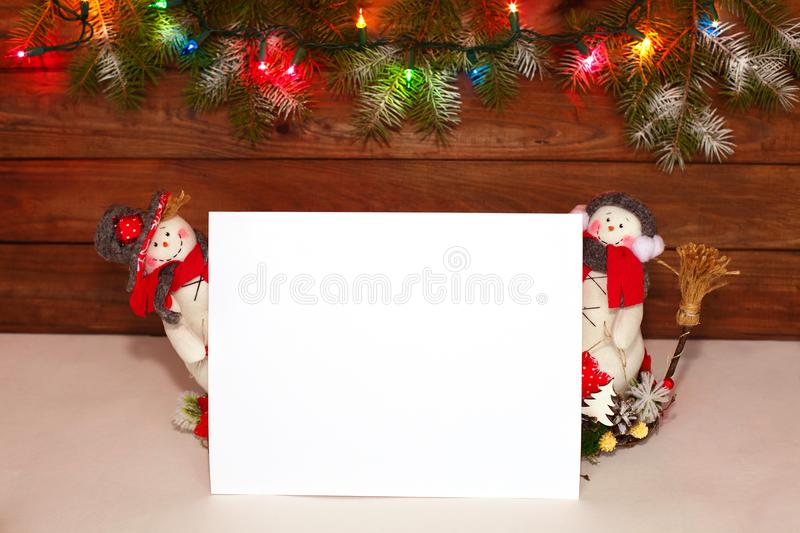 Happy Christmas snowman. Christmas decoration on a wooden background. Greeting card. Xmas decoration. Merry Christmas and a happy New Year card with snowmans stock photo