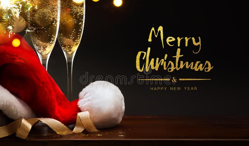 Merry Christmas and happy New year; champagne and Santa hat stock image