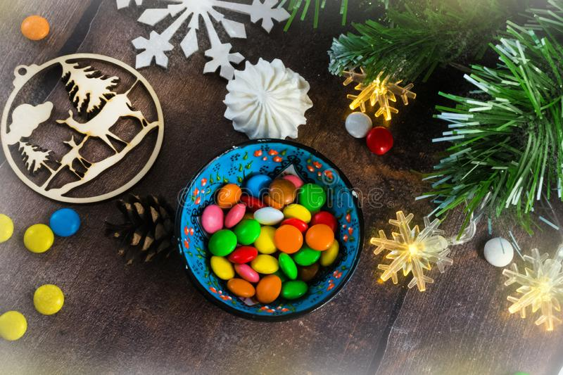 Merry Christmas and happy New year. Christmas decoration design on wooden background with candy bowl.the composition of Christmas royalty free stock images