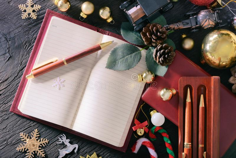 Merry christmas and happy new year concept with book note vintage pen wood and other decoration stock photos
